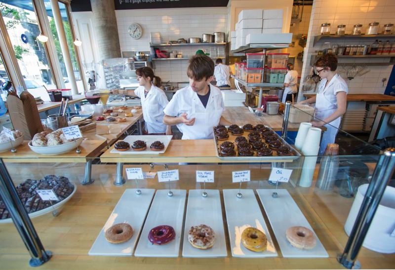 PMG: JONATHAN HOUSE  - Donuts are put on display as Blue Star Donuts opens at its downtown store at SW 12th adn Morrison. As of June 2020 is isclosed permanently.