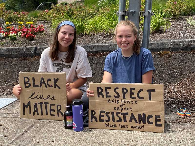PMG PHOTO: HOLLY BARTHOLOMEW - Jadyn Dewey and Sonja Bengston protested for police reform along with other West Linn students Thursday, June 11.