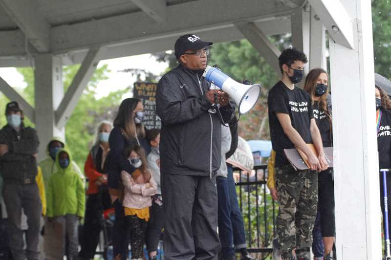 PMG PHOTO: WADE EVANSON - Banks' Ron Hamilton speaks to protesters during a rally in Greenville City Park Friday night, June 12, in Banks.