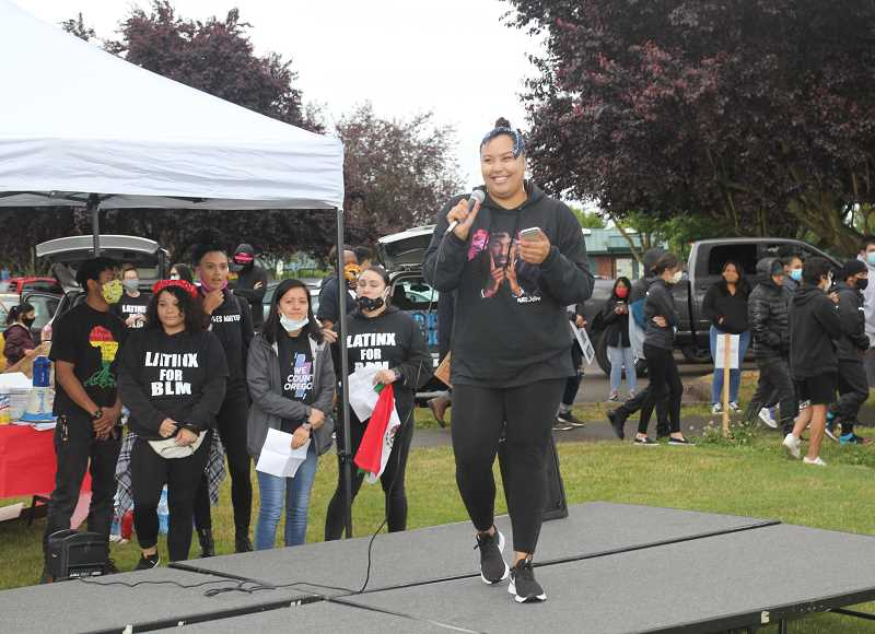 PMG PHOTO: JUSTIN MUCH - Khaya Mathis, who teamed up with Arzel Duarte to organize Black Lives Matter Woodburn, addresses the crowd at the rallys onset in Centennial Park Friday, June 12, 2020.