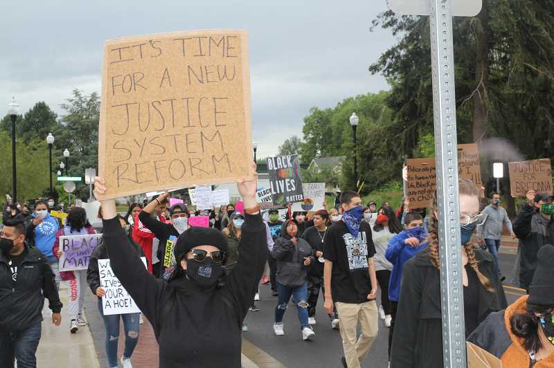 PMG PHOTO: JUSTIN MUCH - Black Lives Matter Woodburn march had a full head of steam by the time it reached downtown on Friday, June 12, 2020.