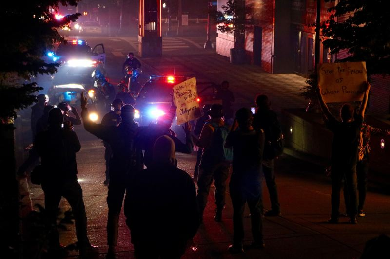 PMG PHOTO: ZANE SPARLING - Protesters faced off with Portland Police Bureau officers near the Arlene Schnitzer Concert Hall on Saturday, June 13.