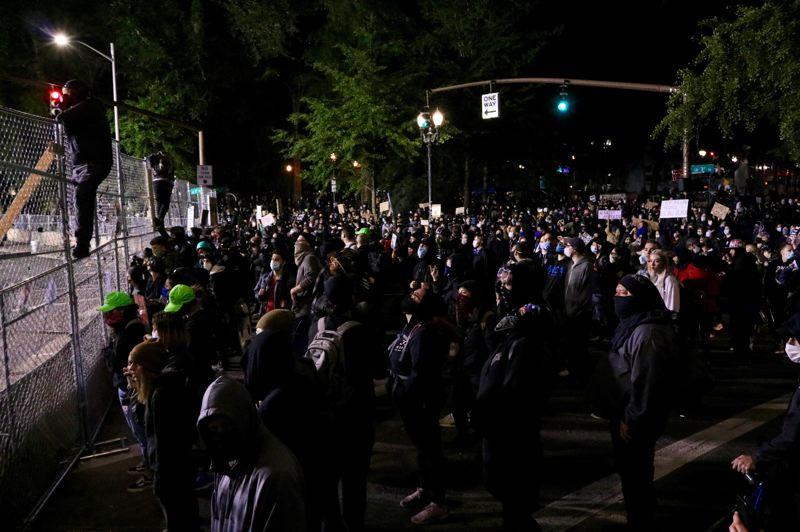PMG PHOTO: ZANE SPARLING - A crowd gathers outside the Multnomah County Justice Center in downtown Portland on Saturday, June 13.