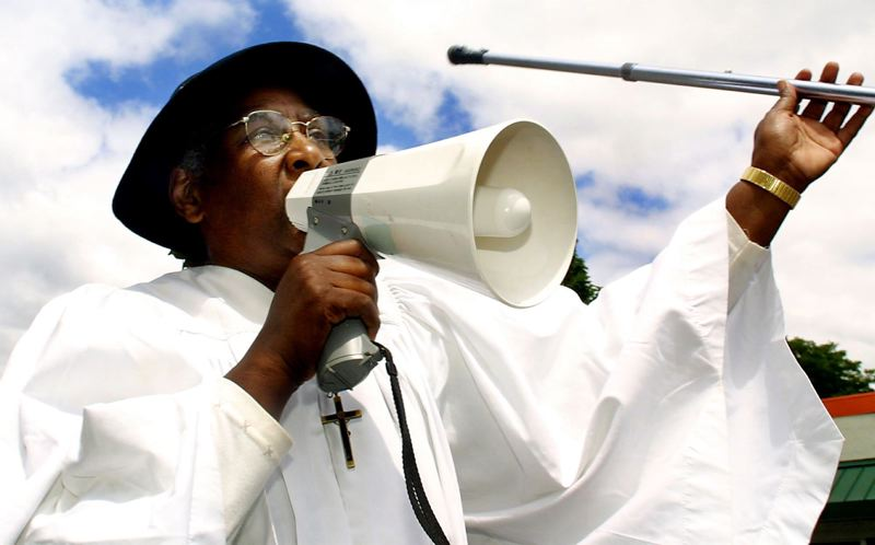 FILE PHOTO - Dressed as Harriett Tubman, Evangelist Shirley Dailey from the Bethel AMC Church leads the Juneteenth Freedom Trail Parade in song as they make their way down Martin Luther King Jr. Boulevard in 2001.