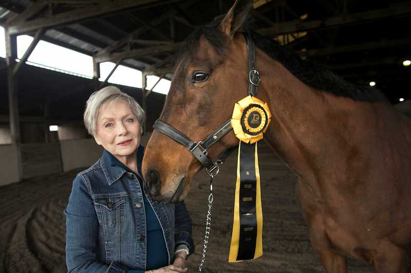 PMG PHOTO: JAIME VALDEZ - Carol McGilvra, a resident of Forest Grove, pictured with her horse, Hanna, will be inducted into a nationally-known group for senior dressage riders and horses in June.