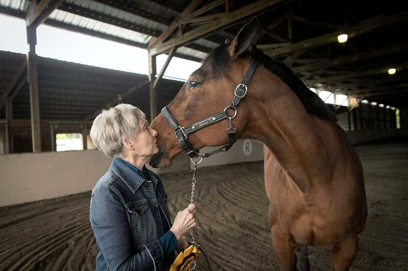 PMG PHOTO: JAIME VALDEZ - Carol McGilvra shares a moment with her horse, Hanna, at Wildflower Trace Stable in Forest Grove.