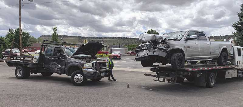 PHOTO COURTESY OF ERIC RICE  - Two of the four vehicles damaged in the crash that originated in a local car wash are towed away.