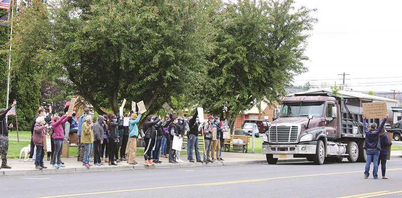 JASON CHANEY - A second Black Lives Matter protest draws a crowd on both sides of Third Street as protestors stood in front of Crook County Courthouse and counter-protestors gathered in front of the Prineville City Hall Plaza.