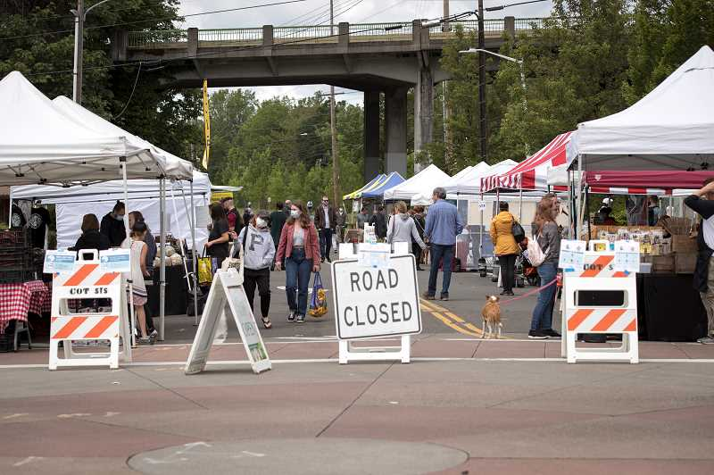 PMG PHOTO: JAIME VALDEZ - Tigard Street was shut off for the Tigard Farmers Market on Sunday. While residents are still attending, attendence is down by one-third.