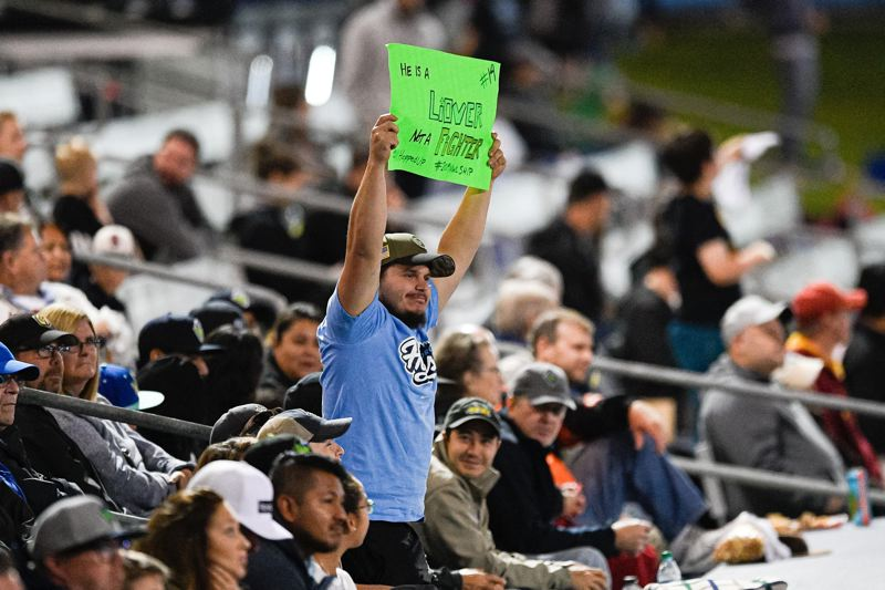 PMG FILE PHOTO: CHRISTOPHER OERTELL - A Hillsboro Hops fan holds a sign to support infielder Liover Peguero during Game 1 of the Northwest League championships against the Tri-City Dust Devils at Ron Tonkin Field on Sept. 7, 2019.