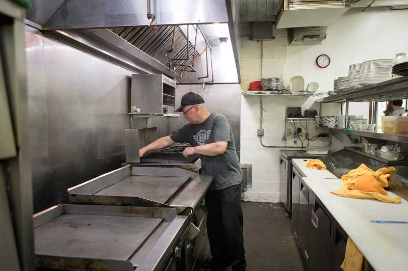 PMG PHOTO: JAIME VALDEZ - Dale Holmes will be the new head chef and and a partner at Maxs Brew Pub, prepares the kitchen for the reopening of the pub, which is expected this week.