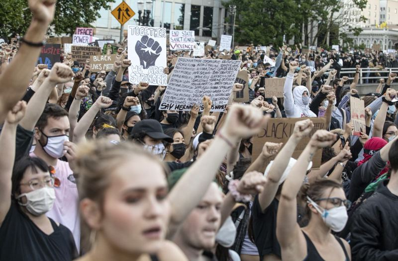 PMG PHOTO: JON HOUSE - Thousands of Black Lives Matter activists pause as they honor George Floyd during a march from Revolution Hall to the SW Waterfront.