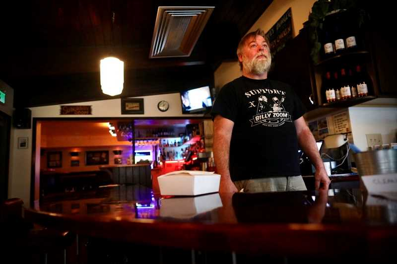 PMG PHOTO: JAIME VALDEZ - Steve Potter, owner of Renner's Grill in Southwest Portland, prepares a takeout order as restaurants in Multnomah County remained closed for dine-in customers. Renner's had just reopened in January 2020 after nearly two years of being closed due to fire damage, before having to close in March due to COVID-19.