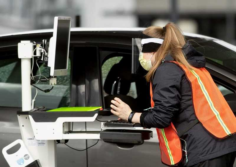 PMG PHOTOS - Drive-in testing for the coronavirus takes place at the Gordon Farber Rec Center in Hillsboro on March 24.