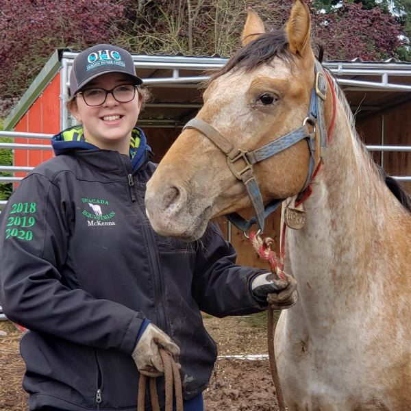 COURTESY PHOTO - Estacada High School student McKenna Neldner is pictured with her mustang, Paisley.