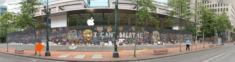 PMG PHOTO: JOSEPH GALLIVAN - The Black Lives Matter memorial mural at the boarded up Apple Store in downtown Portland was started by Emma Berger on June 1. She began with George Floyd's face and the words I CAN'T BREATHE. It quickly grew to include the work of multiple artists and passersby, then crossed the MAX tracks to Pioneer Place.