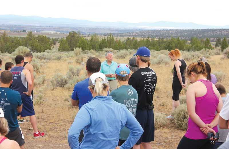 JEFF WILSON/THE PIONEER - Bud Beamer, center, speaks to the 10K runners morning before the 2014 Todd Beamer Memorial Run. This year, the run will take place with social distancing.