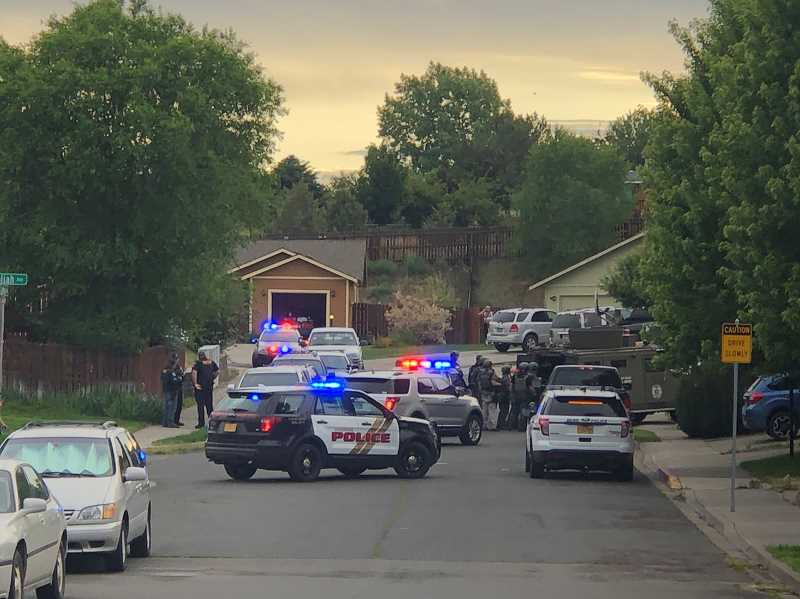 SHANNAN AHERN/FOR THE PIONEER - Madras Police and the Central Oregon Emergency Response Team served a search warrant at a residence in Strawberry Heights Thursday, May 11. Police suspect a man who lives in the residence of forcing his way into an apartemtn on Southwest I Street with a firearm.