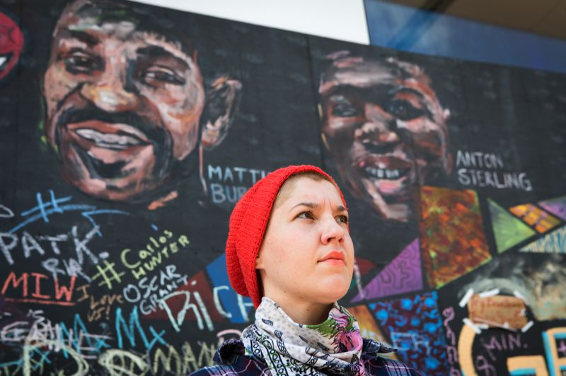 PMG PHOTO: JAIME VALDEZ - Sagan Newham of Portland painted the murals of Matthew Burroughs and Alton Sterling, black men who were killed by police.