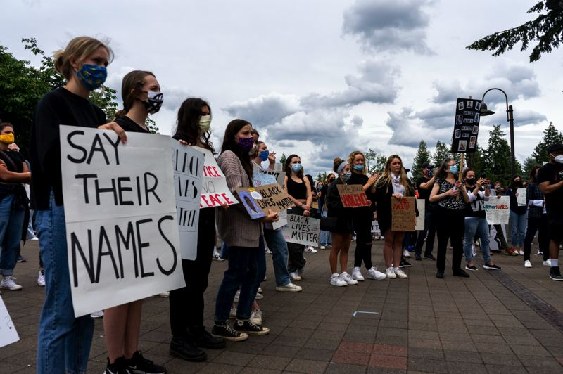 PMG PHOTO: CLARA HOWELL  - Hundreds gathered at a recent protest in Lake Oswego to speak out against police violence and racism.