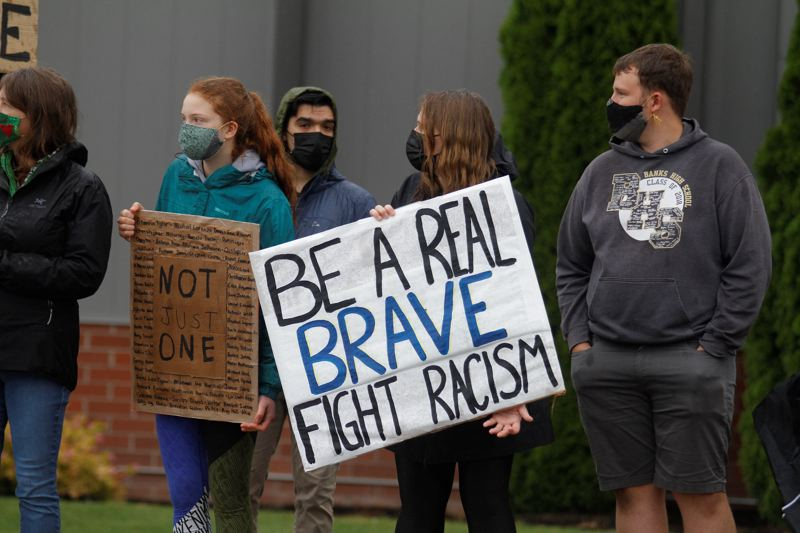 PMG PHOTO: WADE EVANSON - Protesters at a rally in support of the Black Lives Matter movement on June 12 in Banks wear masks, in accordance with public health recommendations.