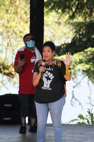 PMG PHOTO: HOLLY BARTHOLOMEW - A Portland woman speaks at Thursday's protest in West Linn about police brutality, racism, silence and what it takes to speak up.