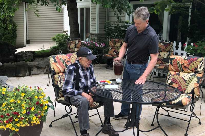 COURTESY PHOTO - Don Beck checks on his father, Austin Beck, at the Rivercrest senior living facility in Oregon City during the COVID-19 pandemic.