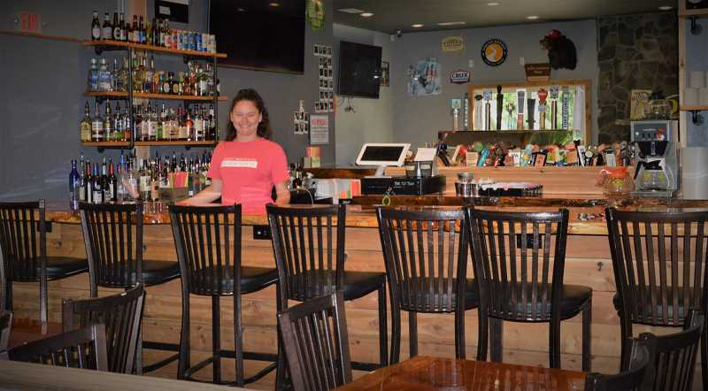PMG PHOTO: CINDY FAMA - Kristina Miller, owner of Goat Mountain Public House, welcomes back her customers as the local pub opens up under Phase 1 guidelines.
