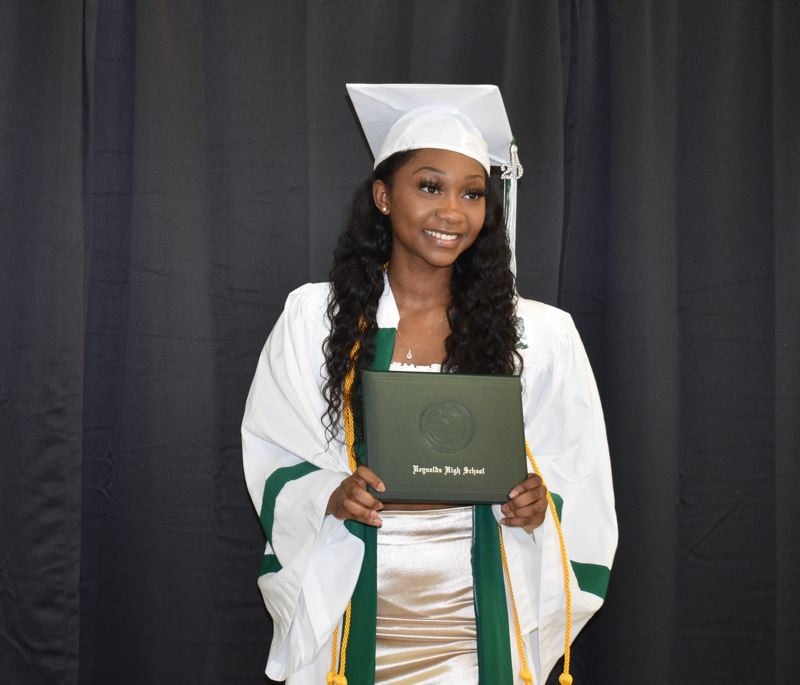 PMG PHOTO: TERESA CARSON - Mariauna Brown, said graduating feels amazing even though it was not what the seniors expected when they started the school year before the coronavirus pandemic hit.