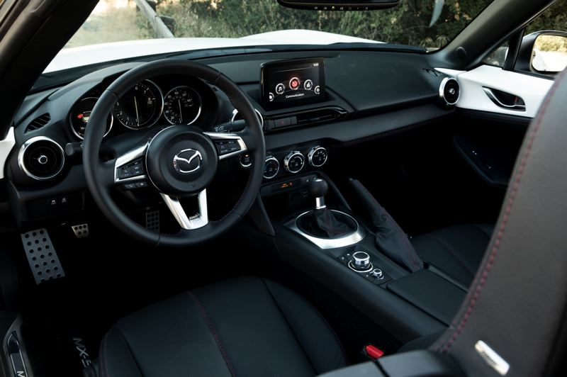 MAZDA NORTH AMERICAN OPERATIONS - The interior of the Mazda MX-5 Miata is just big enough for two people and very little else, which is what a sports car is all about.