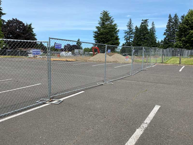 PMG PHOTO: KRISTEN WOHLERS - The area, and part of the parking lot, at Maple Street Park are fenced off for construction.