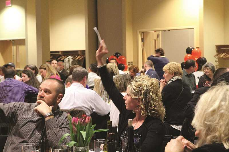 PMG FILE PHOTO - While the social aspect of the event was missed, the success of the auction's online format has given event coordinators another option in future events to reach a wide audience of potential patrons.