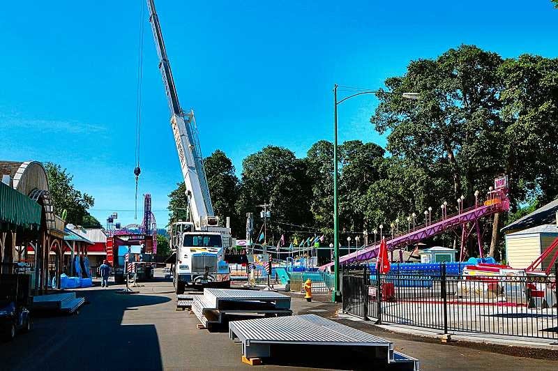 DAVID F. ASHTON - The historic Oaks Amusement Park Midway served as the staging area for large and small parts being used to erect the new extreme thrill ride, AtmosFEAR.