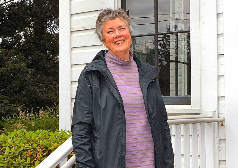 DAVID F. ASHTON - Standing on the steps of one of three local buildings she help list in the National Register of Historic Places - the Oaks Pioneer Church - is award-winning historian Eileen Fitzsimons.
