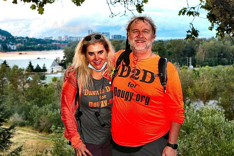 DAVID F. ASHTON - Their dawn-to-dusk trek around Portland completed, and still drying out from the morning showers theyd slogged through, Tatyana and Richard Sundvall caught their breaths at sunset on the bluff overlooking Oaks Bottom.