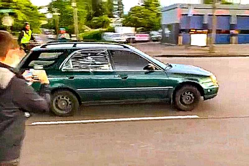 COURTESY KATU-TV-2 NEWS - This is reported to be the motorist who was caught in the protest on Powell Boulevard, and attacked. Police are hunting for those who broke windows and flattened tires on this car.