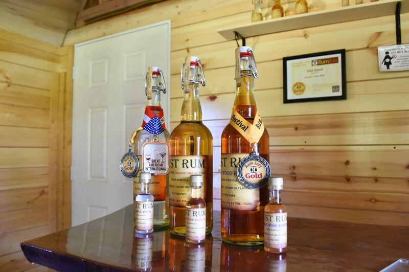 PMG PHOTO: BRITTANY ALLEN  - Just Rum sells three flavors of rum, including Simple White, Oregon Oak Rested and a Maple Wood Rested.