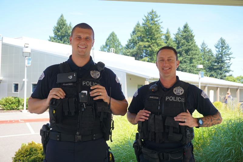 PMG PHOTO: CLAIRE HOLLEY - School Resource Officers James Euscher (left) and Bryan Sheldon.