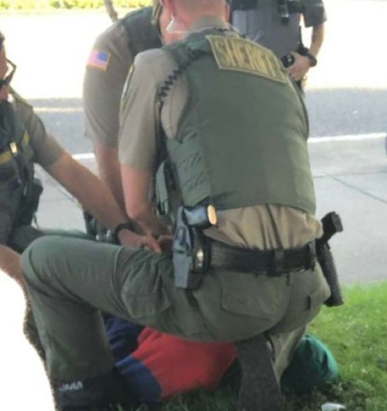 PHOTO COURTESY OF KAFOURY & MCDOUGAL  - Clackamas County Sheriff's Office deputies subdue 12-year-old Ka'Mar Benbo using a knee to the neck.
