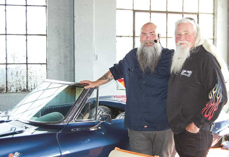 RAMONA MCCALLISTER - Tim Thomas, left, and Bob Nash stand in front of a classic Corvette, which is part of the atmosphere at Crooked River Brewing in Prineville.  Thomas also owns Knucklehead Tattoo in Prineville. The two co-pastor The Church on Main Street that meets at Crooked River Brewing on Sunday mornings.