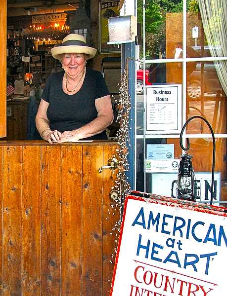 DANA BECK - Joan Blomberg, proprietor of todays American at Heart Store.Raised in Sellwood, Joan returned to the neighborhood to run one of the communitys most established businesses. Business woman by day, and homemaker (and even cattle farmer, for a time) by night.