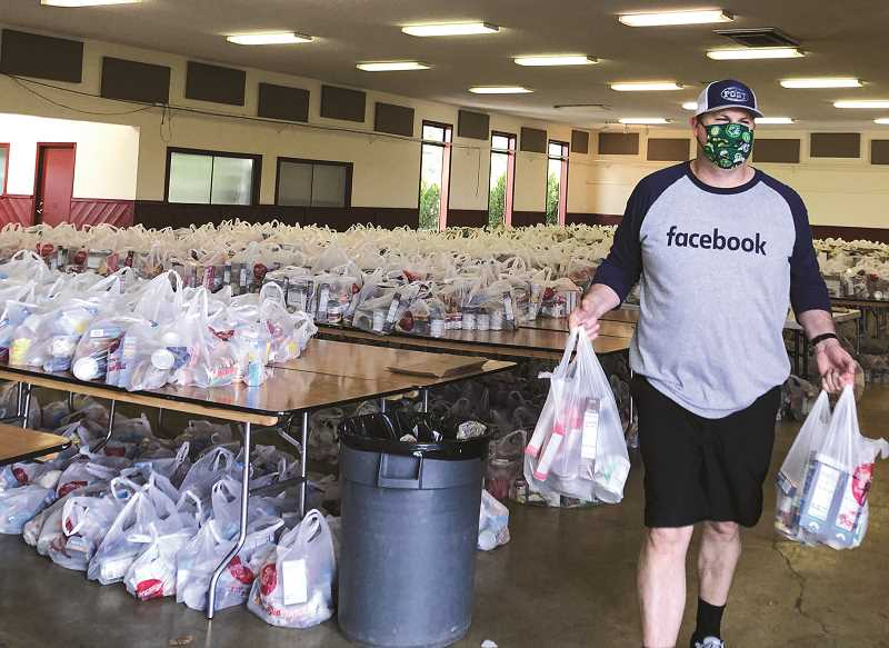 PHOTO SUBMITTED BY VICKY RYAN  - Volunteers were kept busy during the two-day food distribution event at Carey Foster Hall.