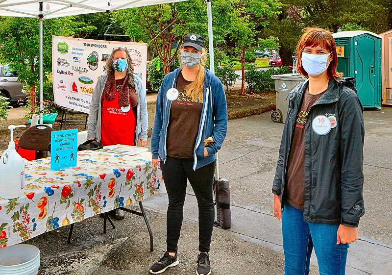 DAVID F. ASHTON - Welcoming back neighbors at the first Woodstock Farmers Market of the season was volunteer Peggy McCafferty, at left - shown with the markets Onsite Coordinator Grace Littig, and its Board President Karena Gruber.