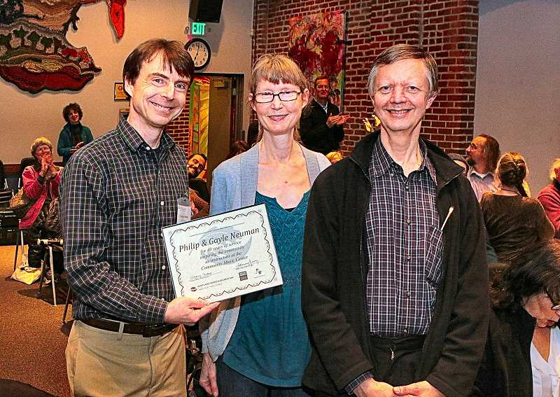 DAVID F. ASHTON - Community Music Center Executive Director Greg Dubay presents a certificate of appreciation to 40-year instructors, Gayle and Phil Neuman.