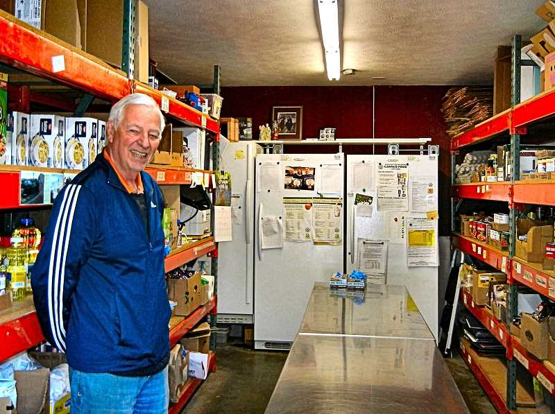 ELIZABETH USSHER GROFF - Dan Hoffa has been volunteering for two decades at the food pantry begun in 1968 at Holy Family Church in Eastmoreland. Shelves are stocked with quality non-expired food every week by volunteers.  During the COVID-19 crisis volunteers have been delivering the food.