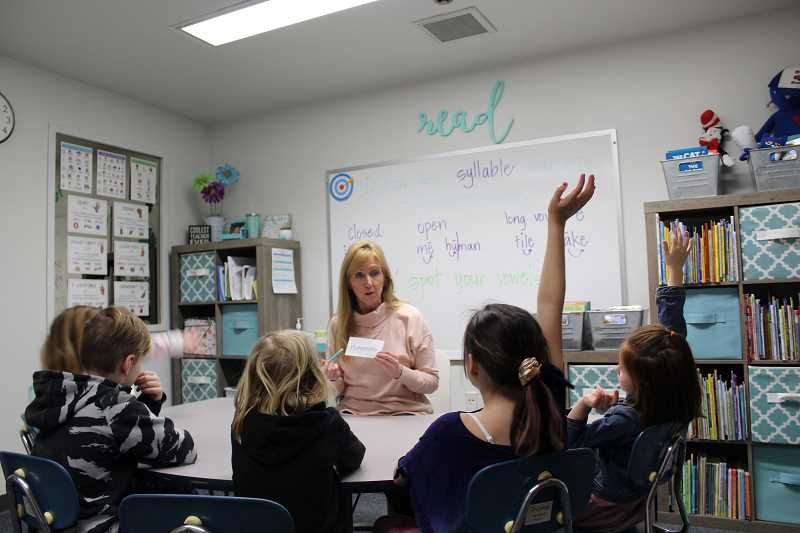 PMG FILE PHOTO - A Lake Oswego teacher works on syllables with her second grade interventin group. A report issued by the Oregon Department of Education shows the number of special education students who graduate on time is falling below state targets.