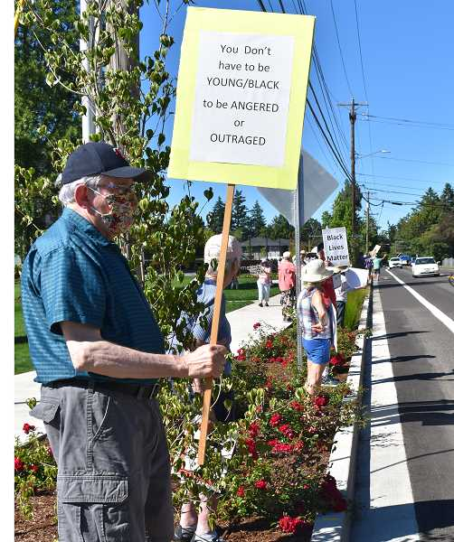 PMG PHOTO: RAYMOND RENDLEMAN - Paul Bosshardt, resident of Willamette View since 2016, 77, was among the protesters on June 22.