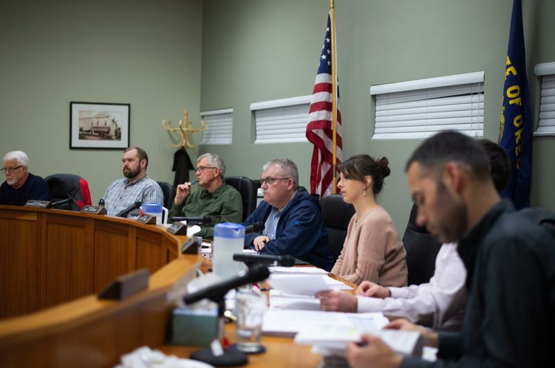 PMG PHOTO: ANNA DEL SAVIO - Scappoose City Council listens to a speaker at a pre-COVID meeting. The City Council recently handed out $30,000 in grants to 11 different community organizations.