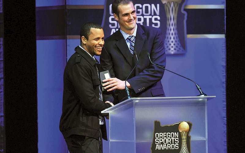 PMG PHOTO: KEVIN HARDEN - Keanon Lowe (left, with former Oregon State quarterback Sean Mannion at the  2014 Oregon Sports Awards) has stepped down from the head coaching job at West Linn High School.