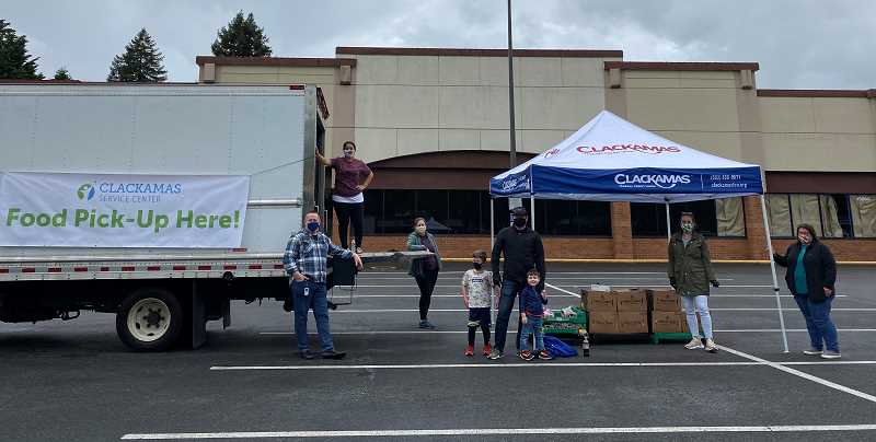COURTESY PHOTO - Clackamas Federal Credit Union volunteers joined staff from Clackamas Service Center to distribute food boxes in Oak Grove.